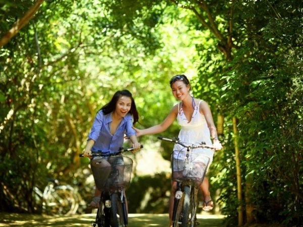 Canva-Two-Friends-Happily-Biking-Together-1